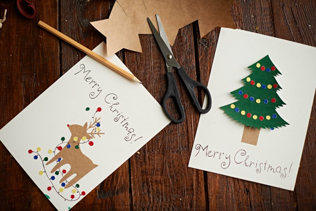 Printed Christmas Card Vs eCard - Newstyle Print Blog - Handmade Cards - craft table of cards